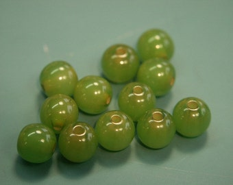 Lot of 25 small rare vintage 1940s round halftranslucent grassgreen genuin tested bakelite plastic beads for your jewelry prodjects