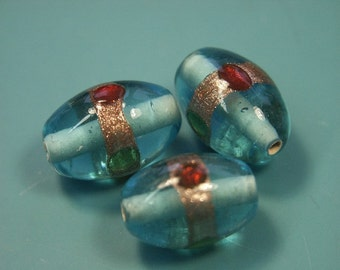 Lot of 3 lovely vintage 1980s handworked translucent light blue foiled oval glass beads for your beading prodjects