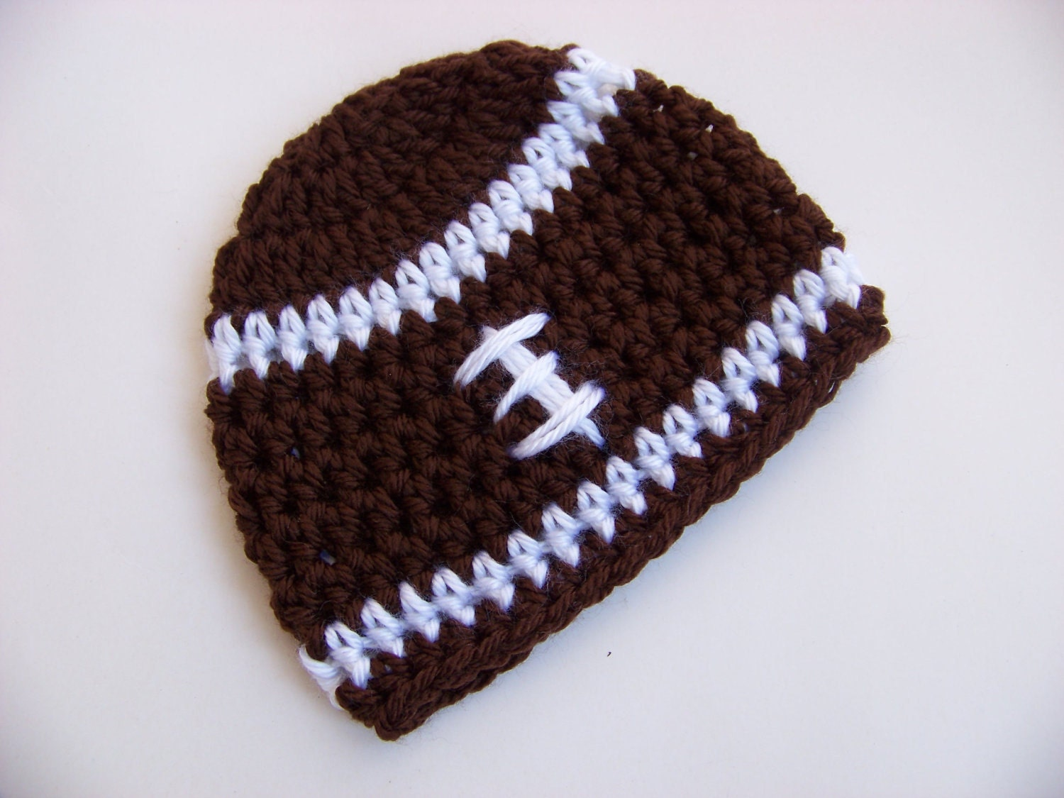 Free crochet pattern for baby football hat manet for crochet baby hat football hat brown with by bellebabyboutique free crochet pattern bankloansurffo Choice Image