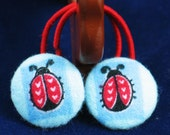 Ladybug on Blue Fabric Covered Button Ponytail Holder