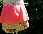 THE MORNING RUSH half apron in coffee n donut themed print and coral pink accent layers and ties