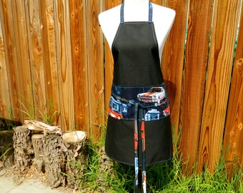 PIT STOP SHOP black chef style apron with navy muscle car scene on pockets and wraparound ties