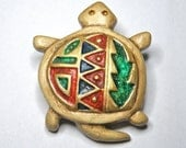 Turtle brooch with southwestern designs.