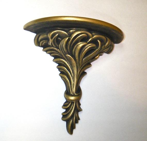 Antique Ceramic Wall Sconces : Antique gold wall sconce. Ceramic shelf.