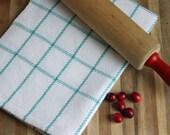 Handwoven kitchen towel / dishtowel in white & robins egg blue windowpane plaid. Handmade by Nutfield Weaver.