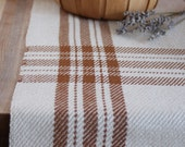 Handwoven farmhouse plaid table runner. Adobe brown & ivory cottons handmade by Nutfield Weaver
