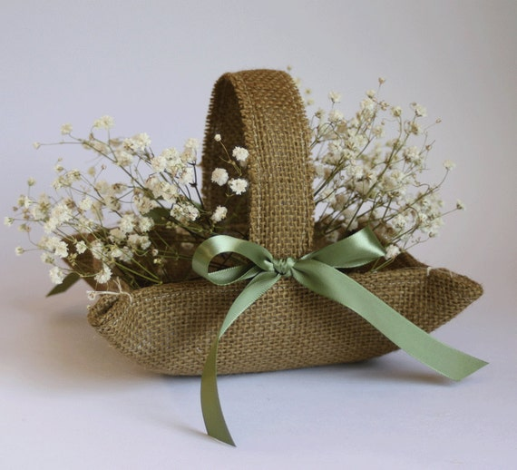 Little brown burlap flower girl basket with moss green ribbon bows for rustic weddings