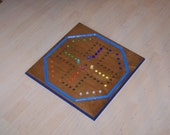 Aggravation game board with marbles sign d by craftsman