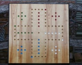 Aggravation Game board w marbles and dice.