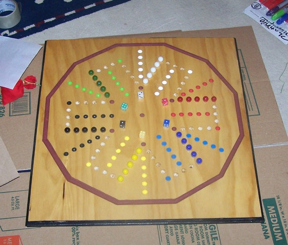 Aggravation board game with marble catch
