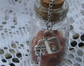 Carnelian with Lock and Key Charms Medium Glass Bottle Necklace