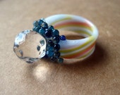 Big clear glass gem on colorful stripe band