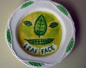 leaf face china plate hand painted reworked