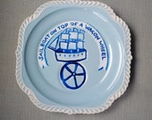 Sail Boat on top of a wagon wheel plate hand painted