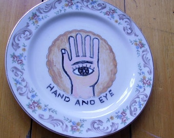 hand and eye china plate hand painted reworked