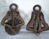 vintage pair of iron barn rope pulleys LOUDIN A28