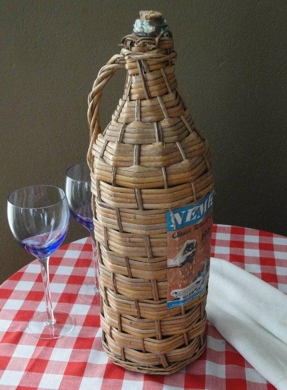 vintage wicker wine bottle wrapped Greek demijohn for candle holder or vase