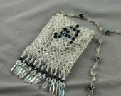 White initial amulet bag