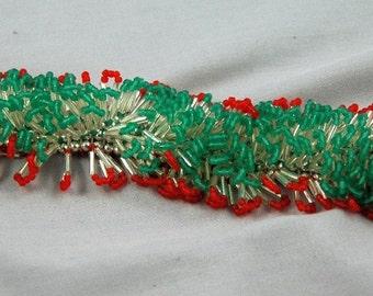 red,green and silver catapillar bracelet