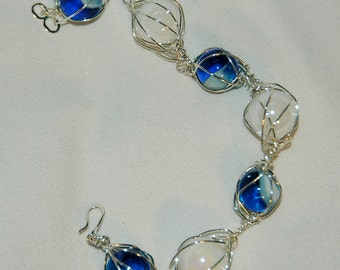 white and blue with white swirl caged marble bracelet