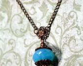 Holding Summer Antique Copper Necklace with Vintage Glass Bead