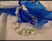Natural pearl, green and blue Swarovski crystal and sterling silver bracelet