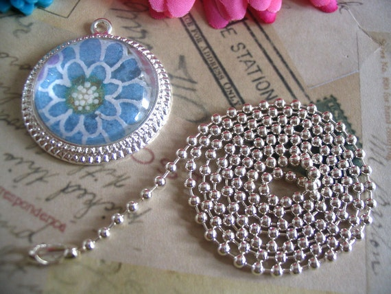 Bundle Pack...10 Silver Pendant Settings..10 Glass Domes...10 Jumprings...10 Chains