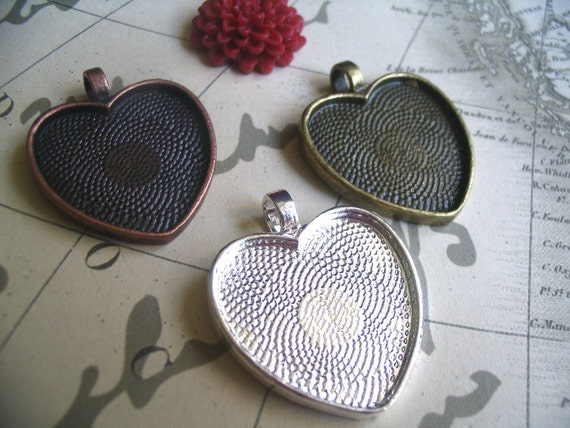 10 Heart Pendant Trays...Mix and Match colors...Great for resin or heart glass domes. Size is 25mm...HRTT
