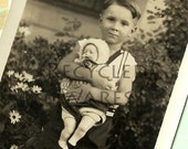 Vintage Boy Holding Doll Photograph Black and White 1950