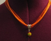 Flirty Pumpkin Orange and Lime Green  with Voile Ribbon Cord and Silver ornate bail