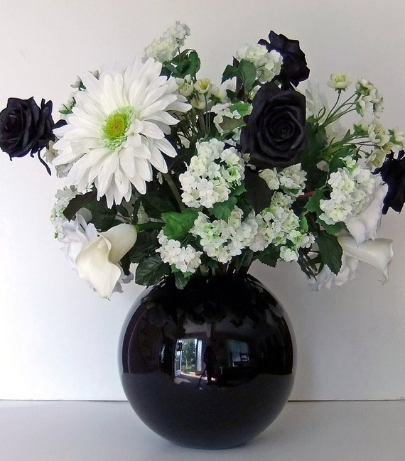 Black and white floral centerpiece in round glass vase