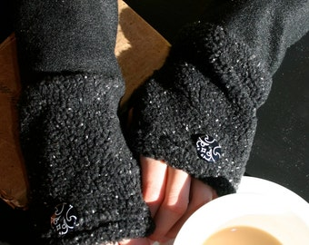 Black faux fur fingerless gloves.