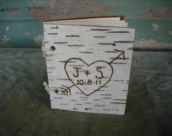 Small Birch bark guest book or journal.  Engraved with your initials and a date. A nice addition to your rustic, woodland, nature wedding.