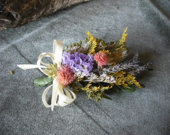 Corsage made with pastel dried flowers and herbs