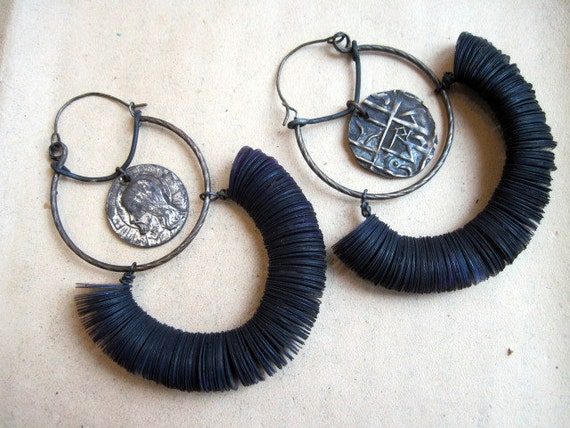 El Silbo. Rustic gypsy hoops with tribal and religious medals.