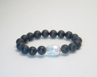 Matte onyx and baroque pearl bracelet