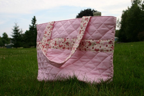 The AMY Reversible Tote Bag with Quilted Solid Pink outer and playful cat fabric lining with Decorative stripe on Exterior