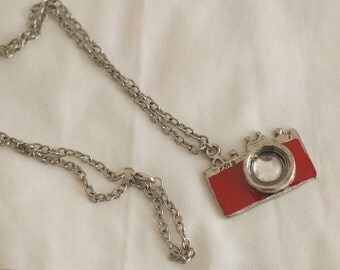 A vintage style camera necklace silver and red