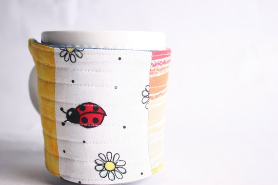 coffee mug cozy, reuseable mug cozy, quilted fabric red, orange, yellow: Ladybug