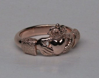 Small Claddagh in 14k red gold  size 5.5 can be sized