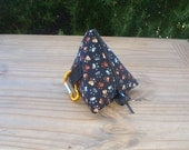 Dog Treat Pyramid Pouch with Belt Loop and Carabiner Clip in a Gold and Silver Pawprint on Black Print