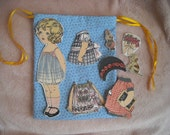 Old Fashioned Cloth Paper doll in drawstring bag (yellow ribbon)
