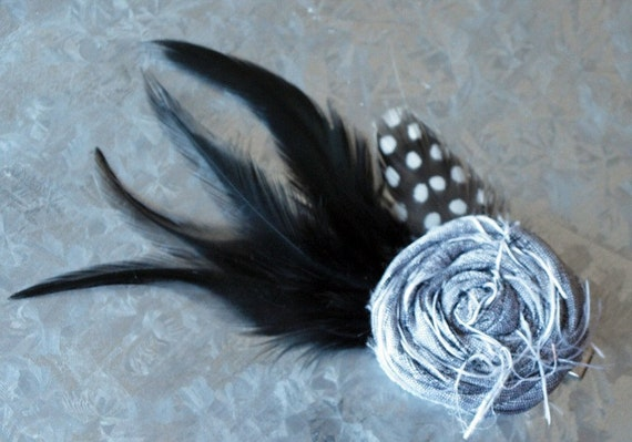Small Siver silk flower accented with black feathers
