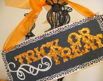Wall Sign, Trick or Treat Halloween Glitter Hanging Sign in Black and Orange with Orange Ribbon