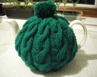 Traditional English Cable Hand knit tea cosy - in forest green fits up to a 6 cup pot.