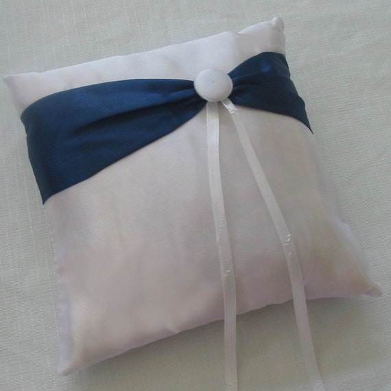white and navy blue ring bearer pillow with white button