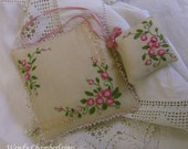 Hand embroidered rose pincushion and scissor keep.