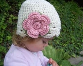 Infant size flower flapper hat cream with pink and green