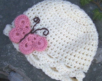 Infant size butterfly hat cream with pink and chocolate brown