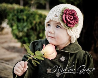 Infant flower hat cream with dark pink and green flower